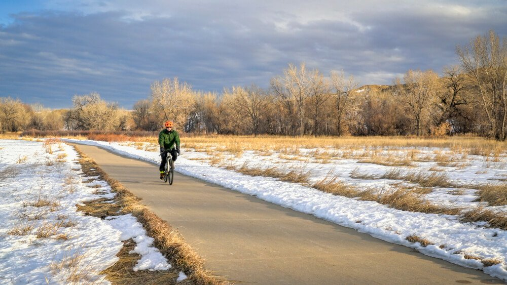 cyclist going down poudre trail