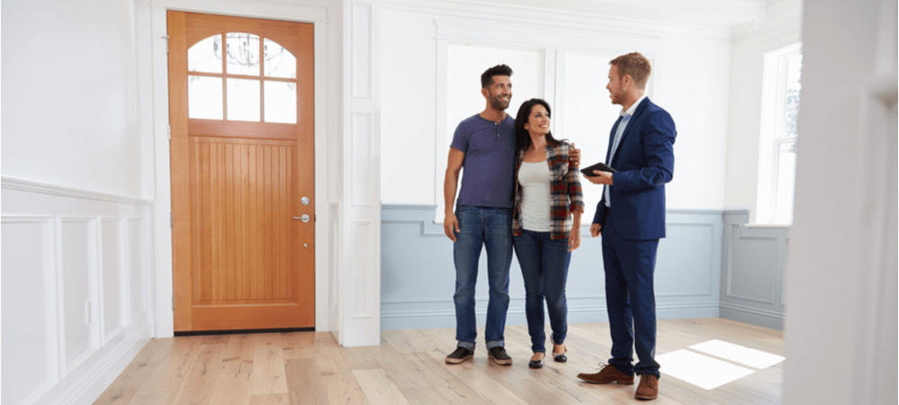 couple looking at a rental home