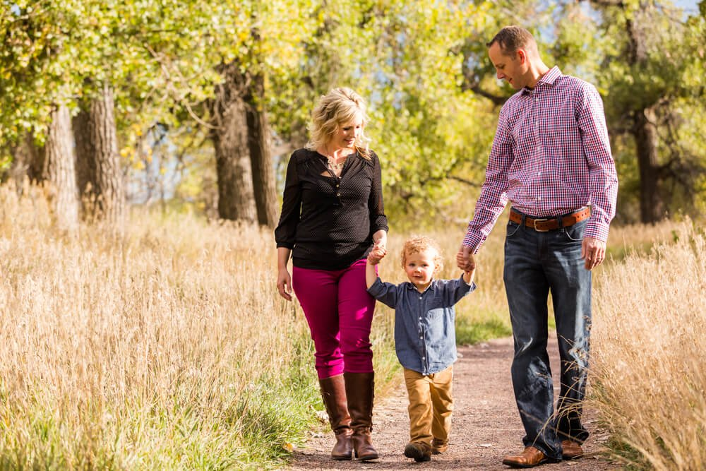 northern colorado family walking with child on a scenic trail