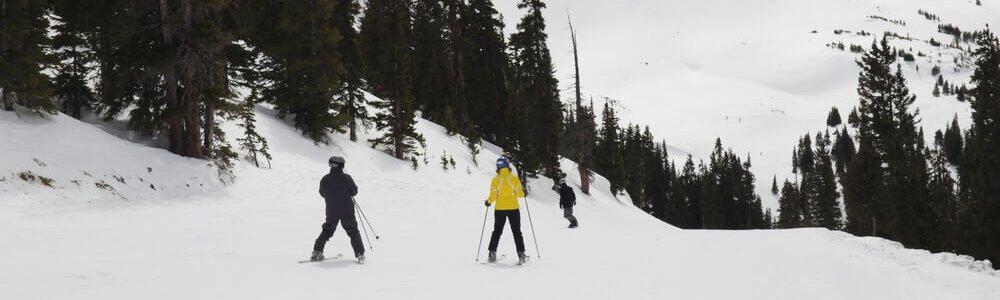 two people skiing down a mountain near loveland colorado