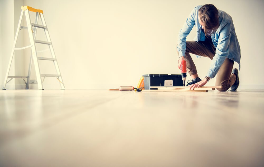 man adding fixes and repairs to a room in his home